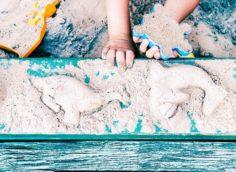 kid-creating-animals-forms-in-sandbox-T89L6G8-236x172